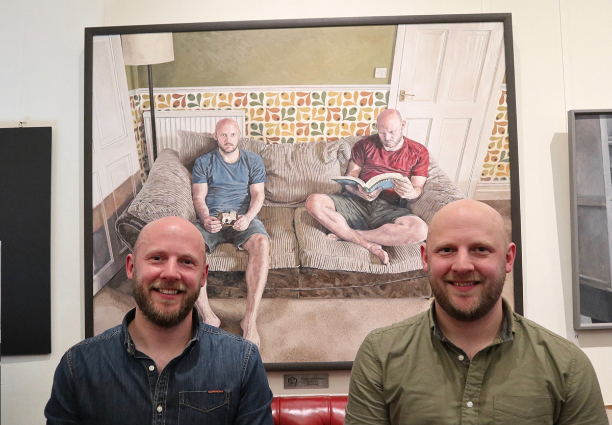 Michael Youds (in blue) with his twin brother David and the portrait that won Michael the £5,000 SPA in Fine Art. (Photo - George McBean