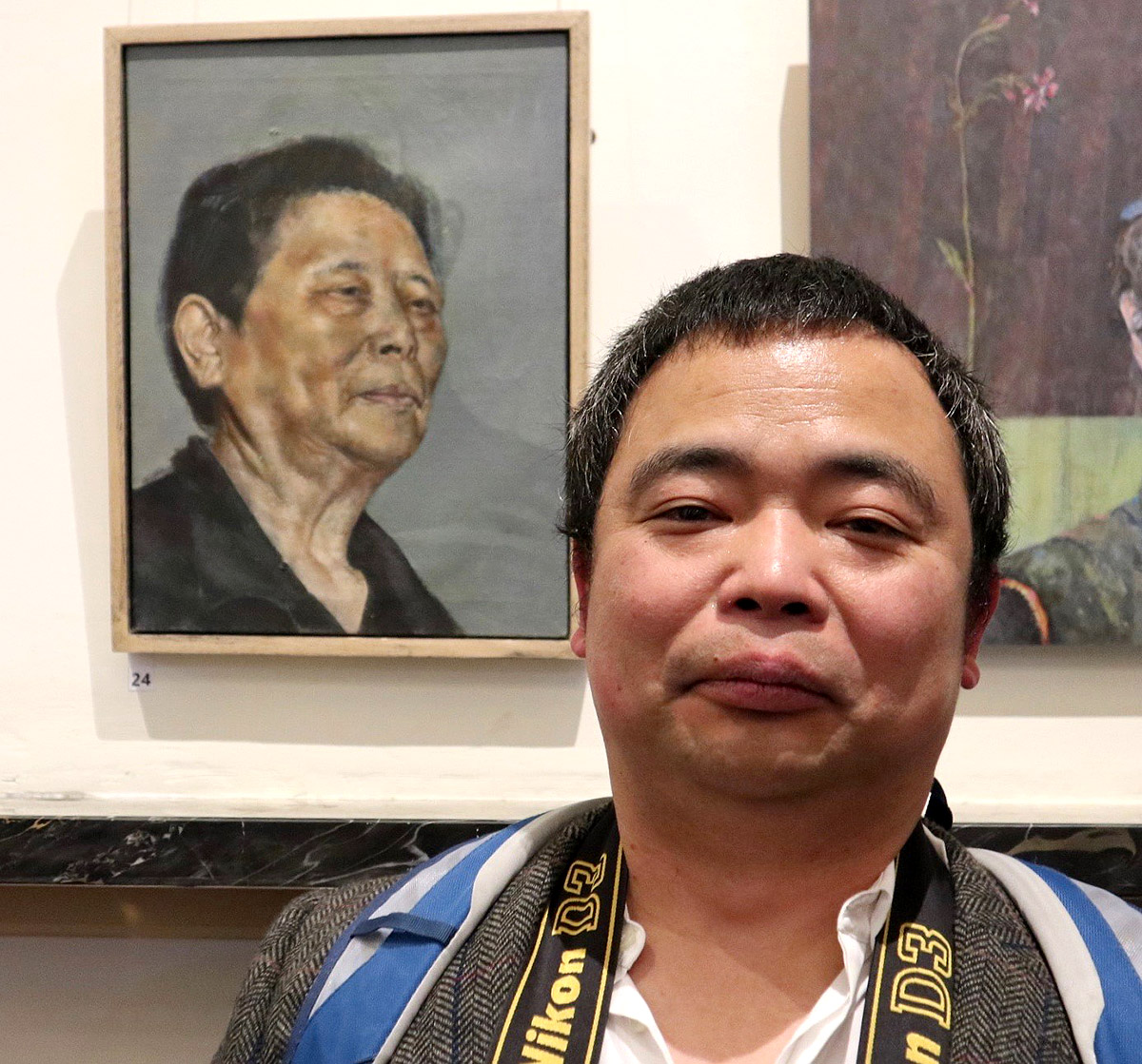 Li Huang, who is studying fine art in Dundee, with his portrait Kinship, third prize in the SPA in Fine Art 2019. (Photo by George McBean)