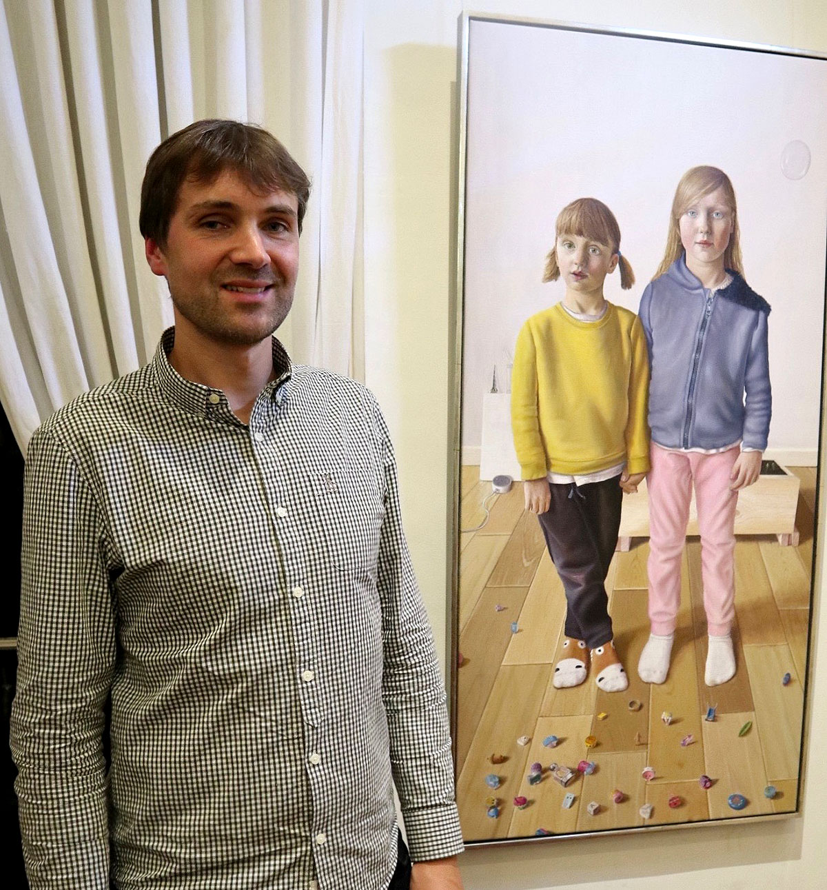 Saul Roberston with his portrait Us into Others, Others into Us (second prize) (Photo George McBean)